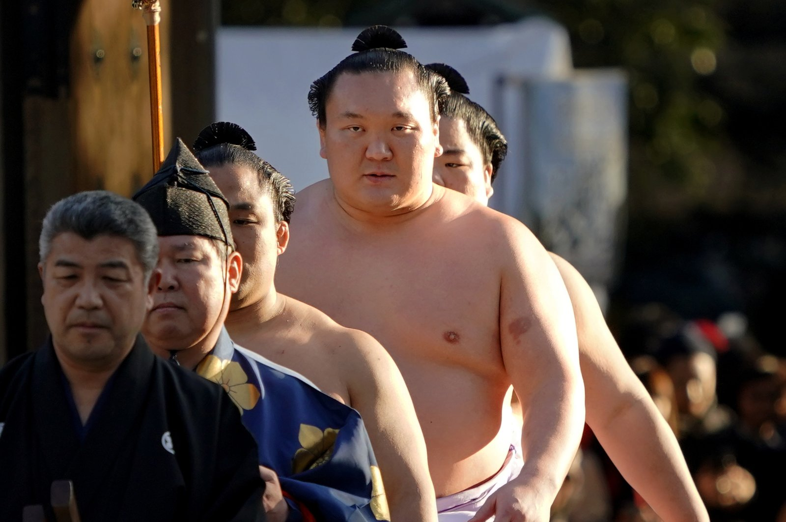 Hakuho, second from right, arrives to perform his ring entry, in Tokyo, Japan, Jan. 9, 2018. (AP Photo)