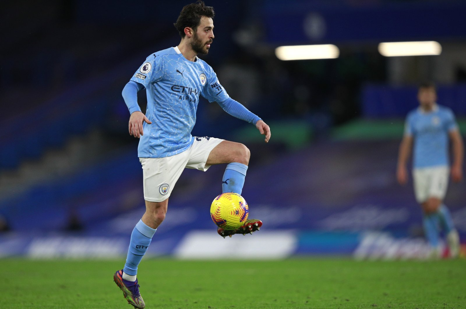 Manchester City's Bernardo Silva controls the ball during a Premier League match against Chelsea at Stamford Bridge, in London, England, Jan. 3, 2021. (AP Photo)