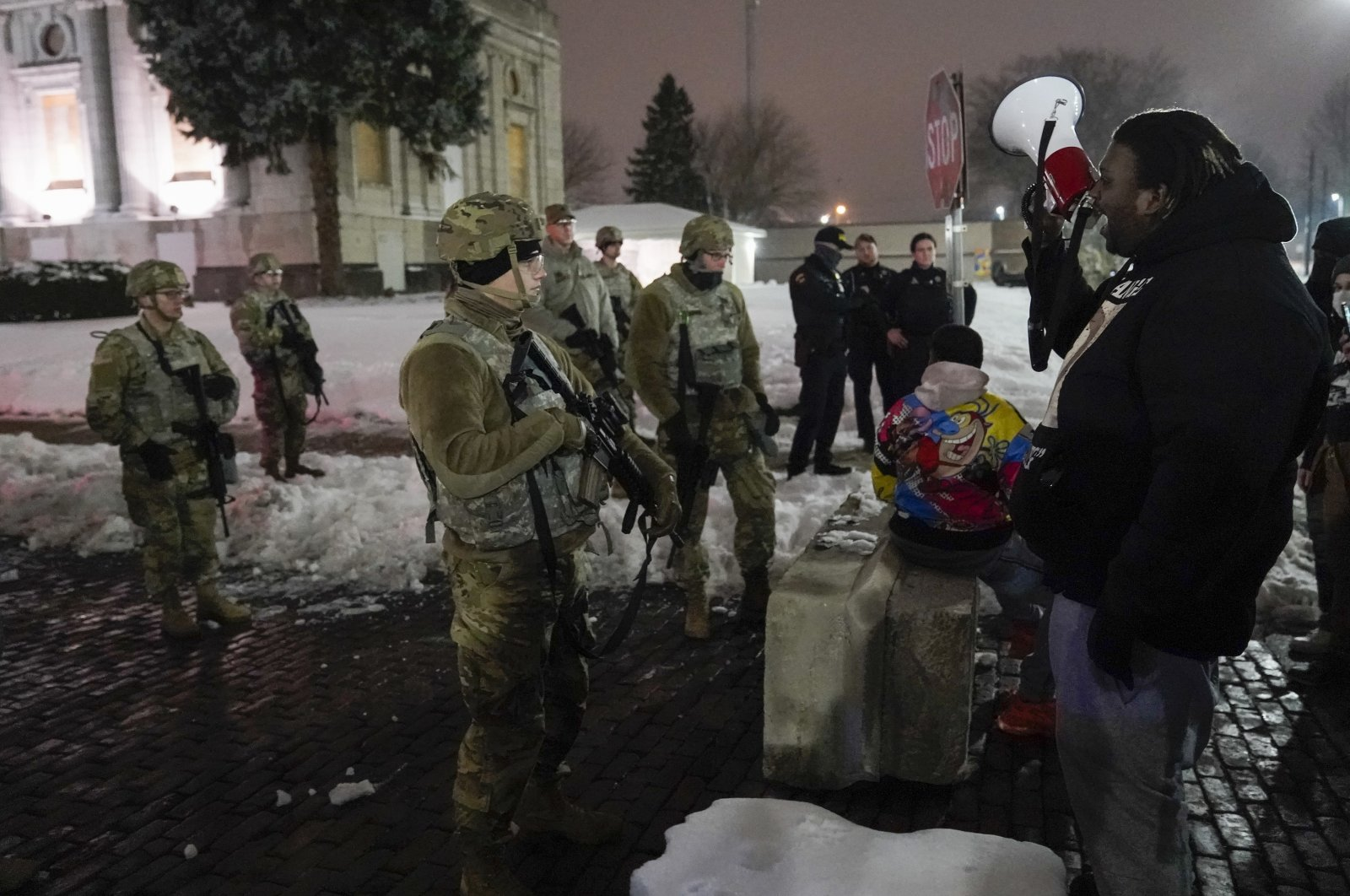 A group of protesters confronts National Guard members outside a museum, in Kenosha, Wisconsin, U.S., Jan. 5, 2021. (AP Photo)