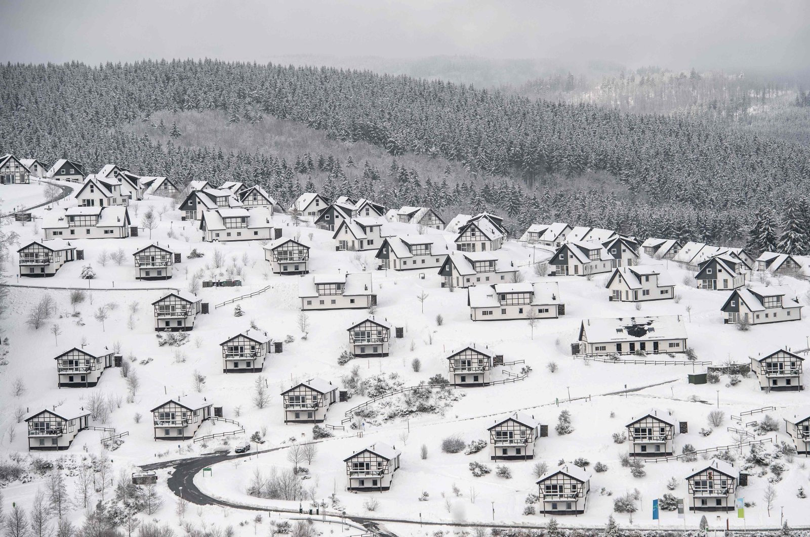 Vacation homes covered in snow in a holiday park, Winterberg, western Germany, Jan. 1, 2021. (AFP Photo)