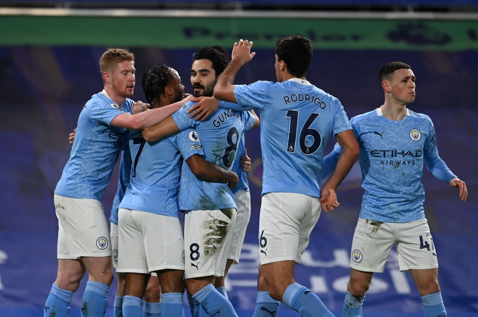 Manchester City players celebrate a goal during a Premier League match against Chelsea at the Stamford Bridge, in London, Jan. 3, 2021. (AFP Photo)