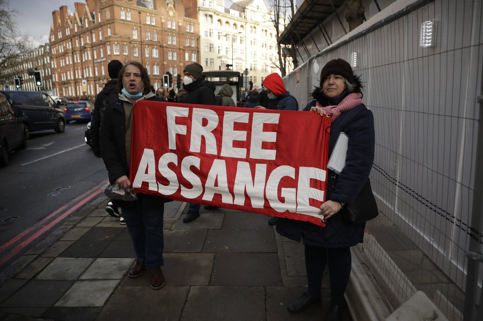 Julian Assange supporters react outside the Westminster Magistrates Court after Julian Assange was denied bail at a hearing in the court in London, Jan. 6, 2021. (AP Photo)