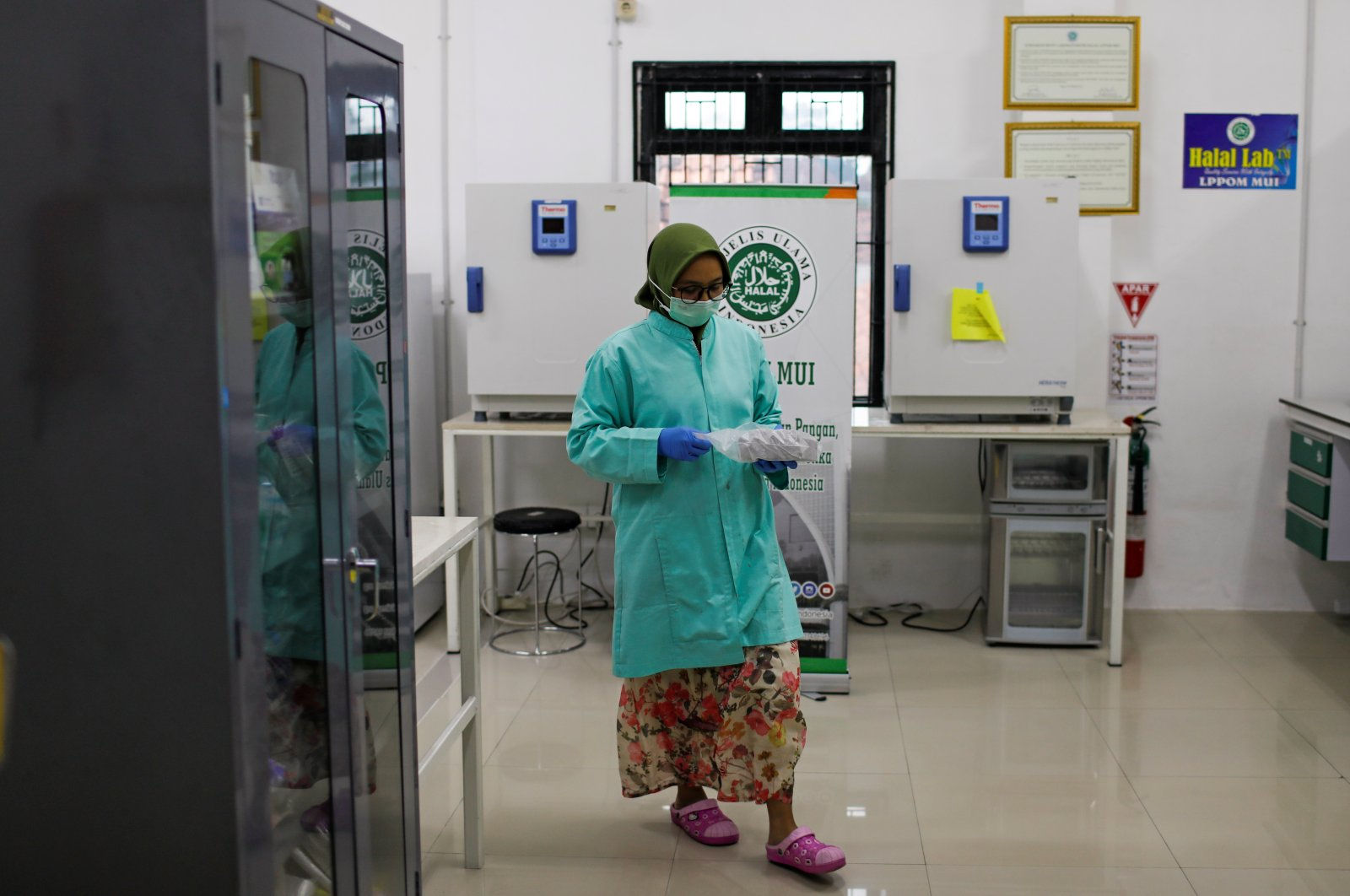 An analyst at the Global Halal Center walks inside a laboratory, where Sinovac's vaccine for the coronavirus disease (COVID-19) was analyzed for halal certification, in Bogor, Indonesia, Jan. 6, 2021. (Reuters Photo)