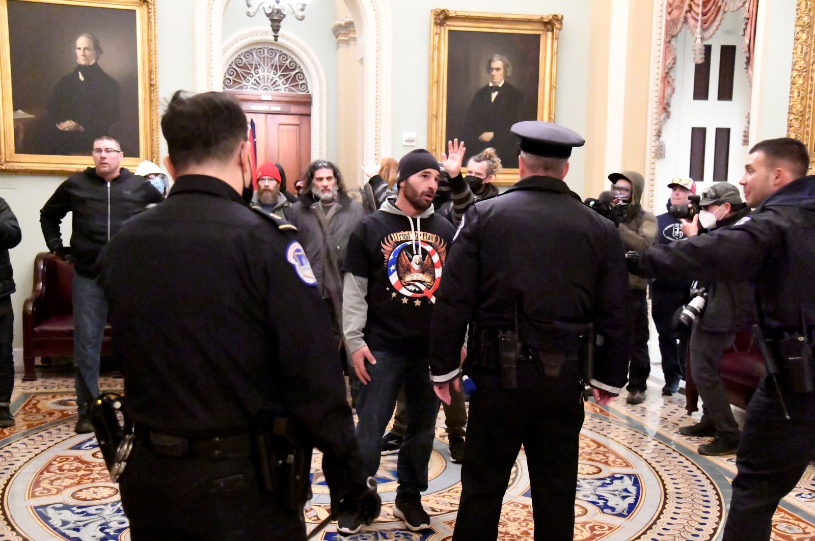 Police confront supporters of President Donald Trump as they demonstrate on the second floor of the U.S. Capitol near the entrance to the Senate after breaching security defenses, in Washington, U.S., Jan. 6, 2021. (REUTERS Photo)