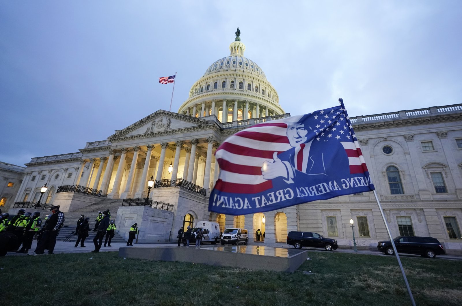 Trump supporters left a flag outside the Capitol, Wednesday evening, Jan. 6, 2021, in Washington. (AP Photo)