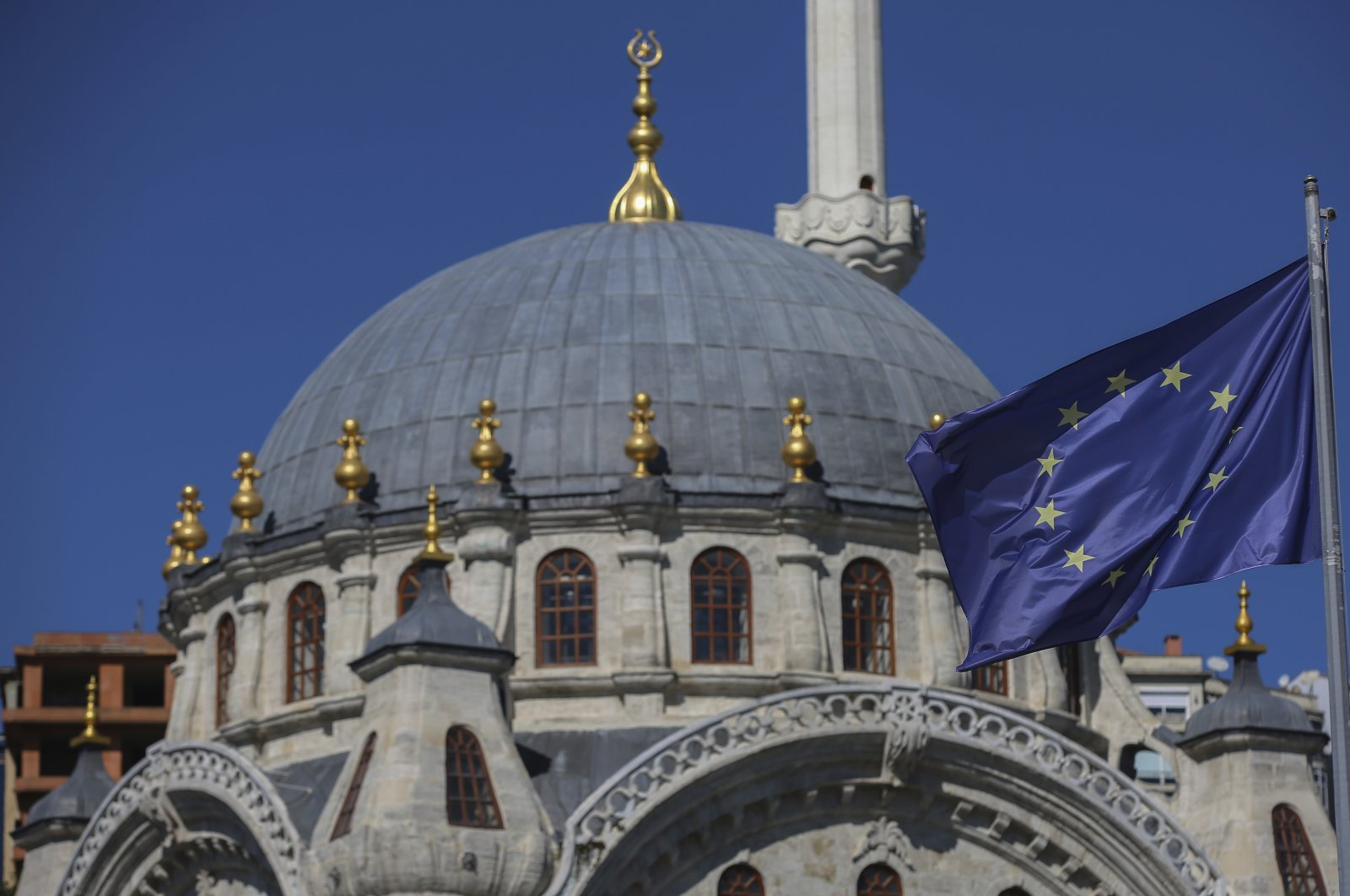 A European Union flag flaps in the wind in front of Nispetiye Mosque in Istanbul, Turkey, Oct. 12, 2017. (AP Photo)