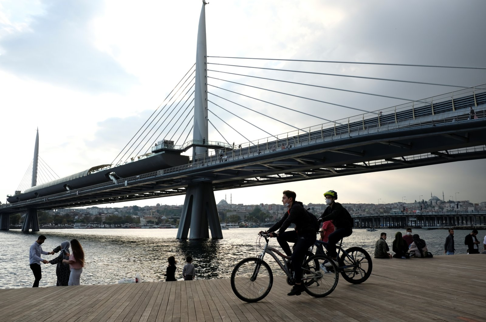 People on bicycles pass the Golden Horn, Istanbul, Turkey, Oct. 10, 2020. (Reuters Photo)