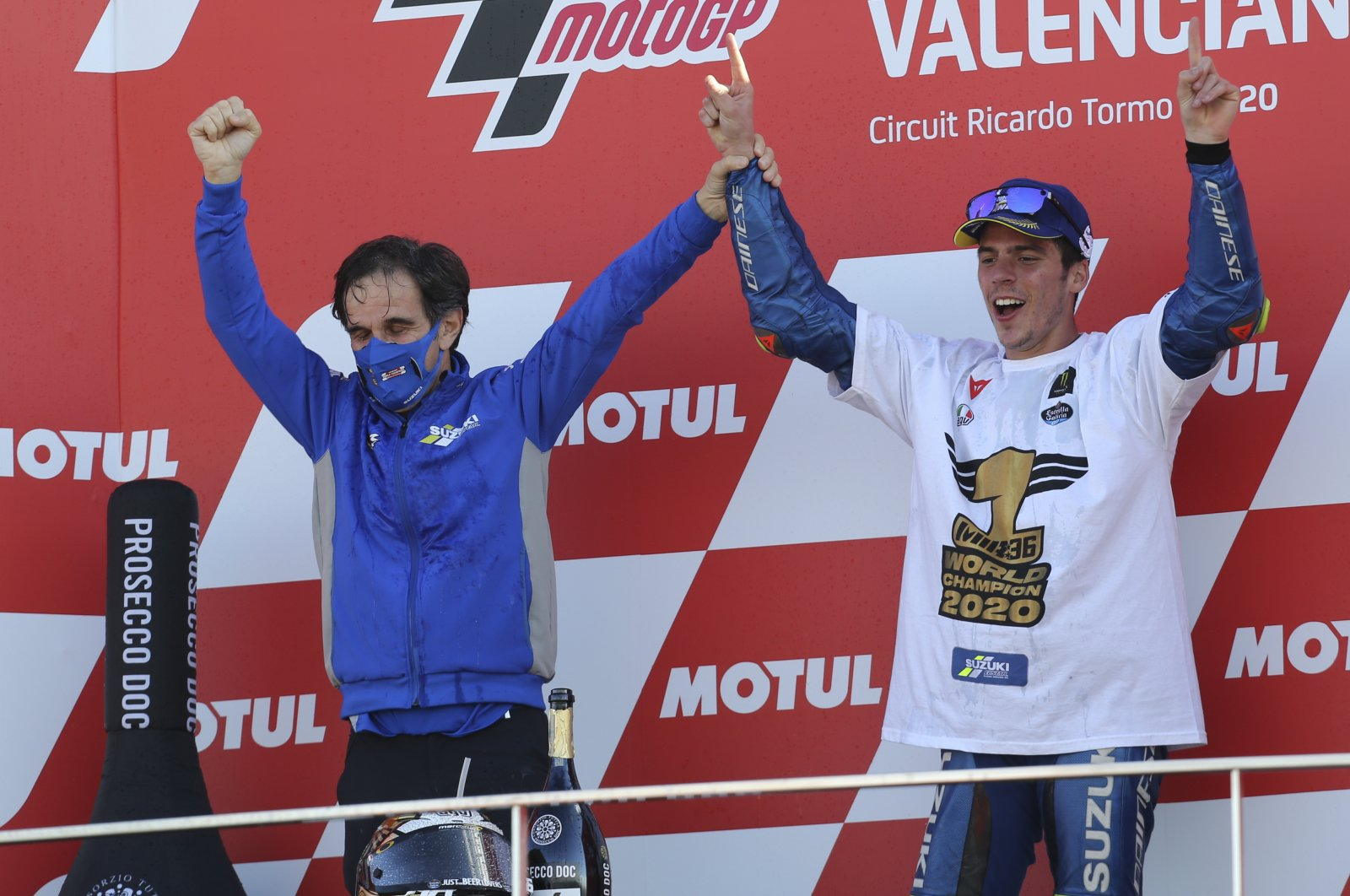 Suzuki manager Davide Brivio (L) and rider Joan Mir celebrate after winning MotoGP Valencia Grand Prix at the Ricardo Tormo Circuit, in Valencia, Spain, Nov. 15, 2020. (AP Photo)