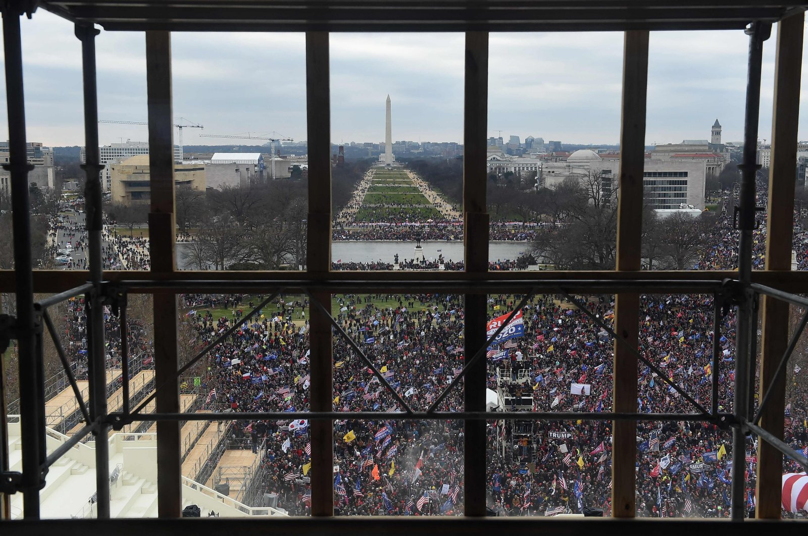 Supporters of U.S. President Donald Trump are seen from behind scaffolding as they gather outside the U.S. Capitol, Washington, D.C., U.S., Jan. 6, 2021. (AFP Photo)