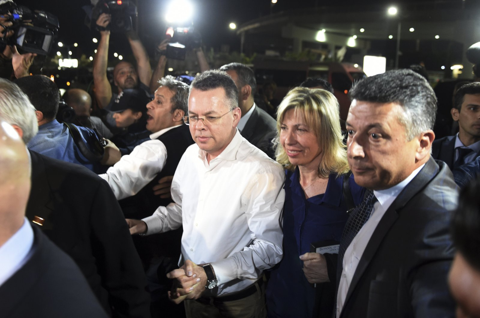 Andrew Brunson (C) arrives at the airport after his release, in Izmir, western Turkey, Oct. 12, 2018. (AP Photo)
