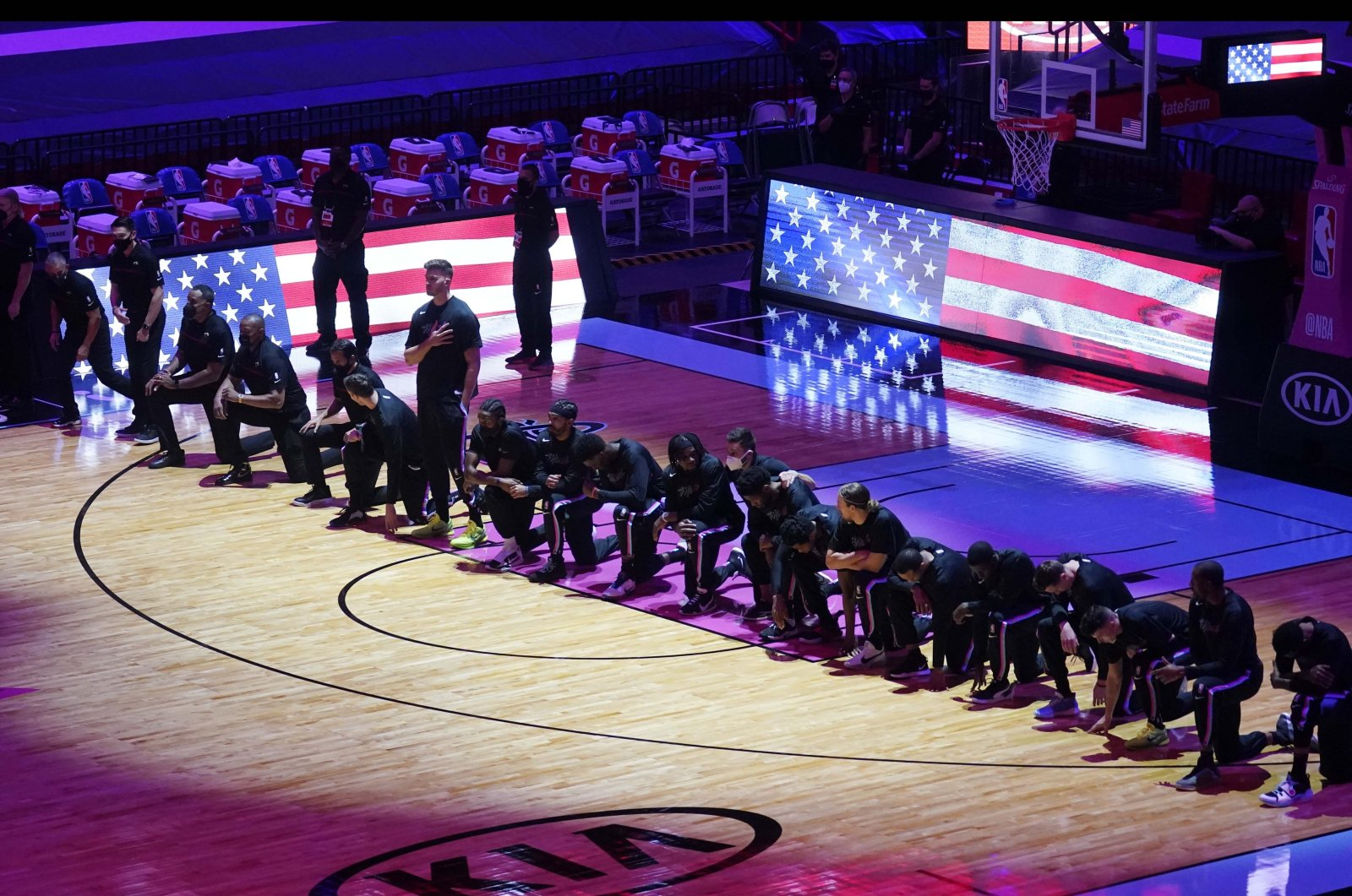 The Boston Celtics team kneels during the U.S. National Anthem before an NBA game against the Miami Heat, in Miami, U.S., Jan. 6, 2021. (AP Photo)