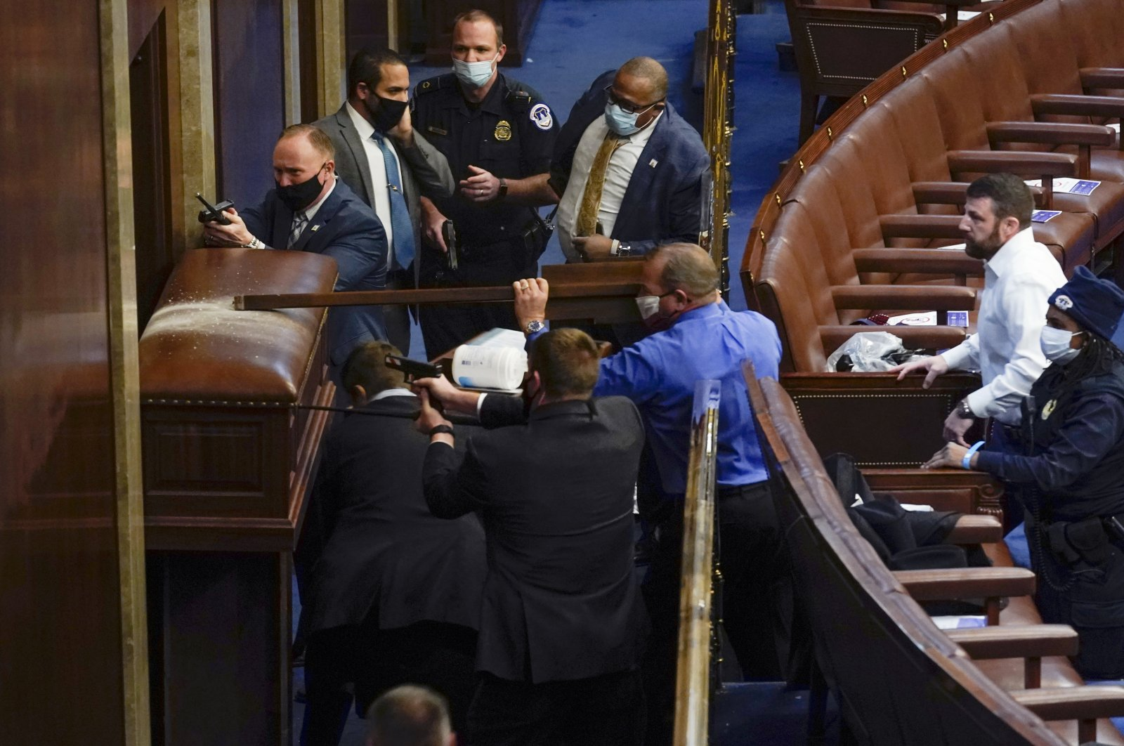 U.S. Capitol Police with guns drawn stand near a barricaded door as protesters try to break into the House Chamber at the U.S. Capitol on Wednesday, Jan. 6, 2021, in Washington. (AP Photo)