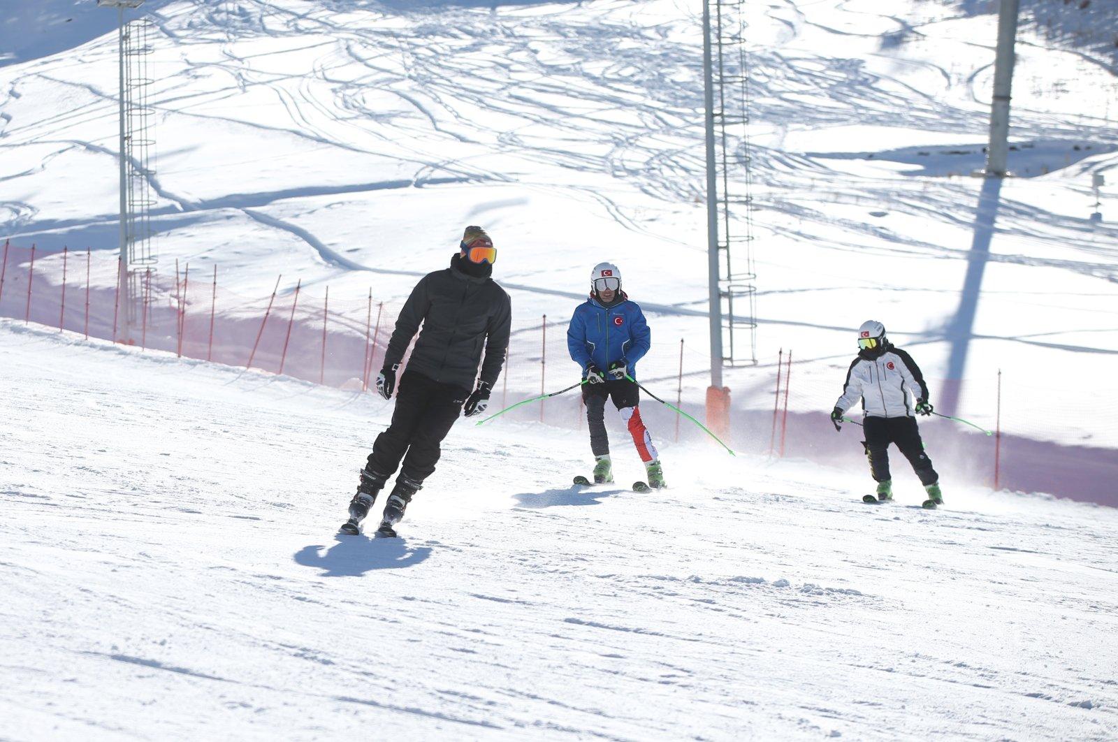 People ski before the start of a partial COVID-19 curfew on New Year's Eve, Palandöken, Erzurum, eastern Turkey, Dec. 31, 2020. (AA Photo)
