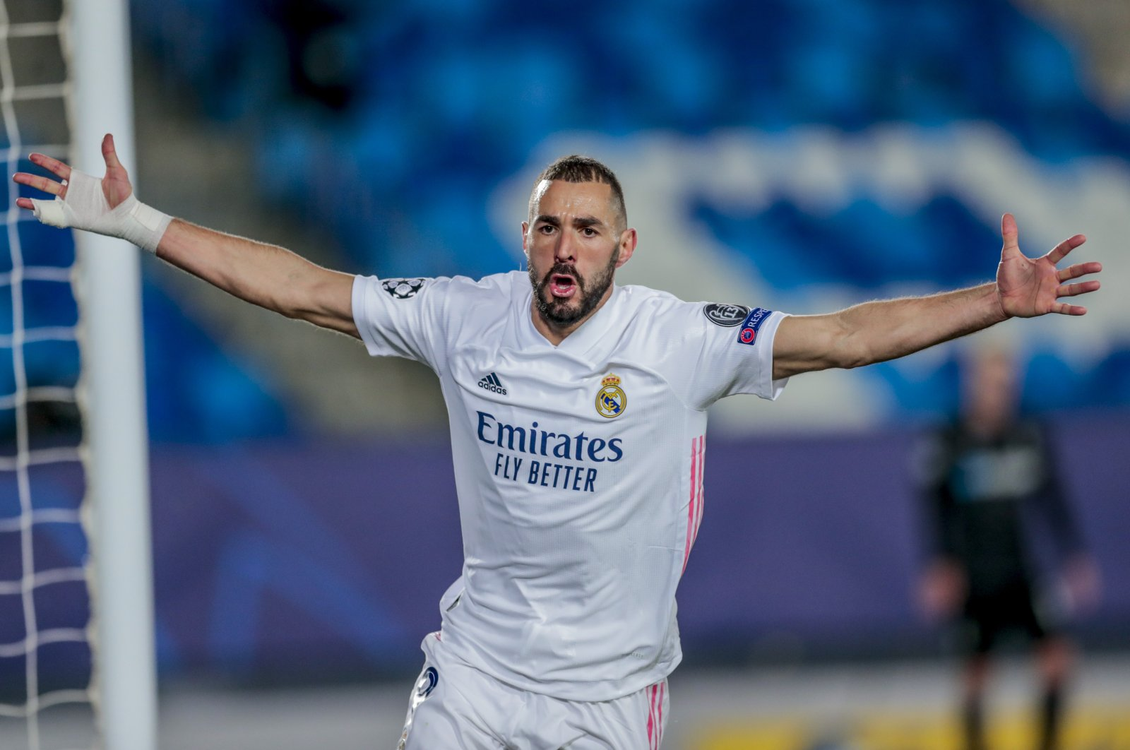 Real Madrid's Karim Benzema celebrates after scoring the opening goal during the Champions League group B football match between Real Madrid and Borussia Monchengladbach at the Alfredo Di Stefano stadium in Madrid, Spain, Dec. 9, 2020. (AP Photo)