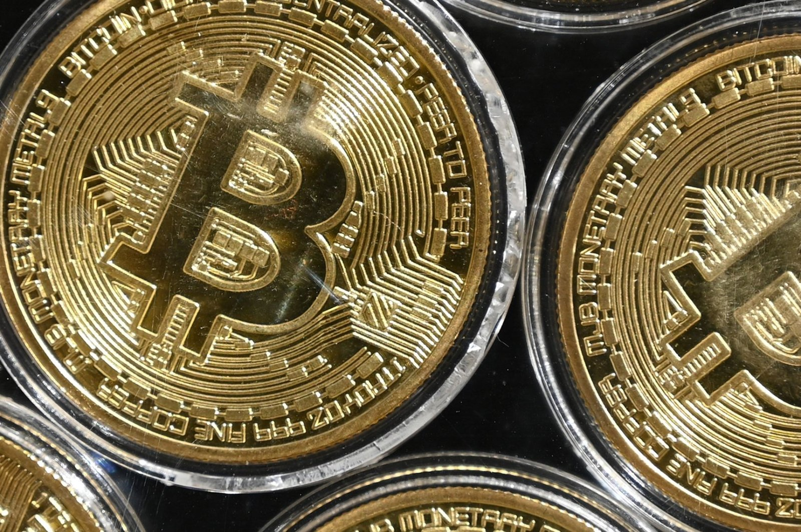 Physical imitations of Bitcoins seen at a cryptocurrency shop, near the Grand Bazaar, in Istanbul, Sept. 24, 2020. (AFP Photo)