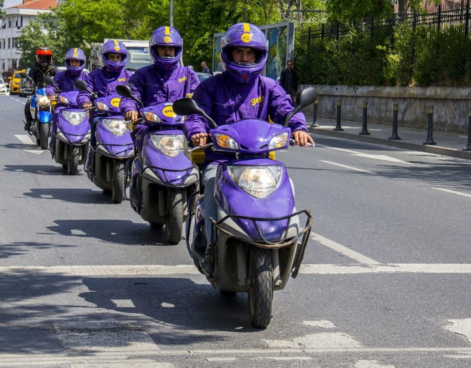Getir moto-couriers line up in a street in Turkey, Jan. 17, 2020. (IHA Photo)