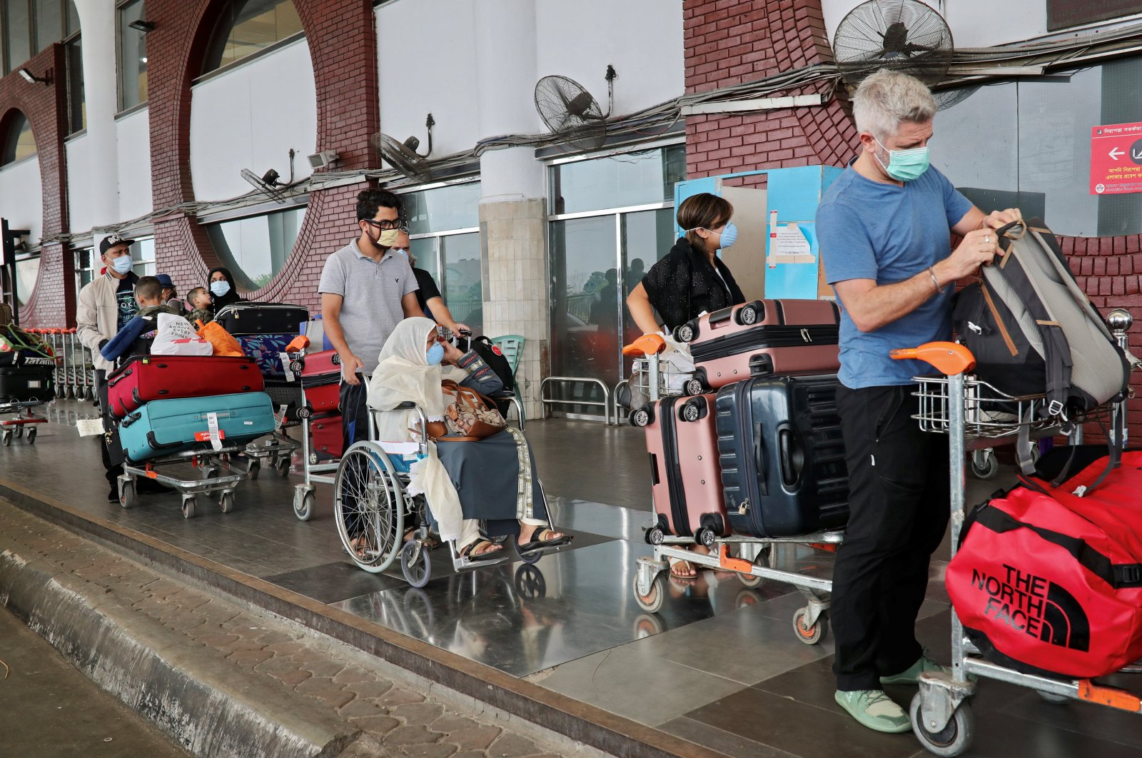 Citizens of UK arrive at the Hazrat Shahjalal International Airport to leave Bangladesh on a special flight amid the coronavirus outbreak in Dhaka, Bangladesh, April 21, 2020. (Reuters Photo)