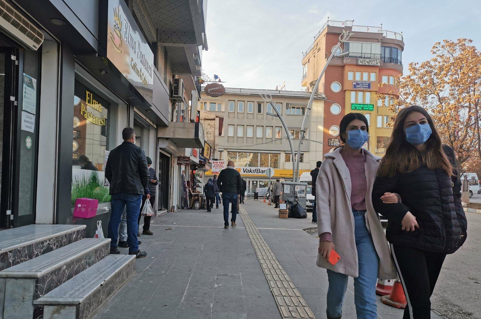 People wearing protective masks walk on a street in Tunceli, eastern Turkey, Jan. 8, 2021. (DHA Photo)