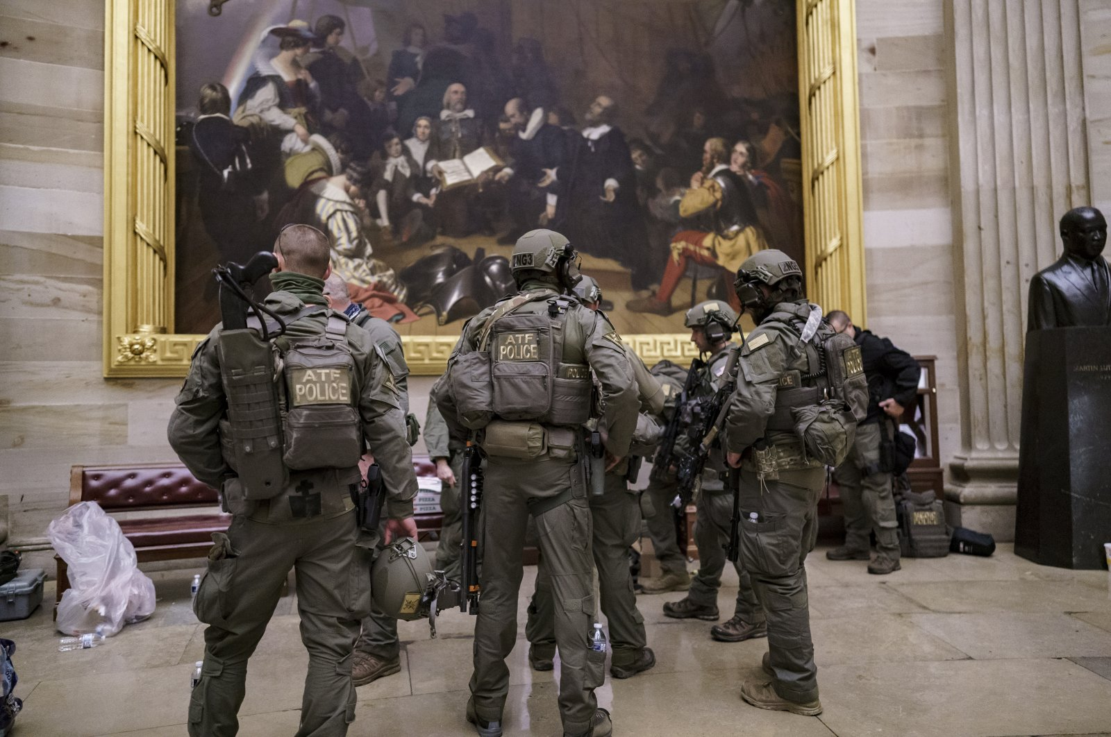 After violent protesters loyal to President Donald Trump stormed the U.S. Capitol, an ATF tactical team gathers in the Rotunda to provide security for the continuation of the joint session of the House and Senate to count the Electoral College votes cast in November's election, at the Capitol in Washington, D.C., U.S., Jan. 6, 2021. (AP Photo)