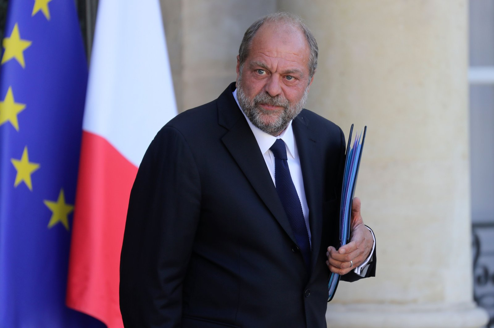 In this file photo, French Justice Minister Eric Dupond-Moretti leaves after attending the first weekly Cabinet meeting after the government reshuffle, at the Elysee Palace in Paris, July 7, 2020. (AFP Photo)