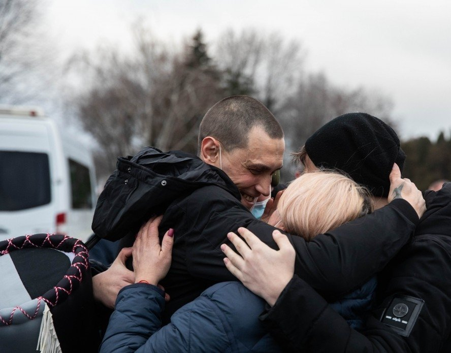 A Ukrainian sailor hugs his family after returning from five years of detention in Libya, Jan. 8, 2021. (AA Photo)