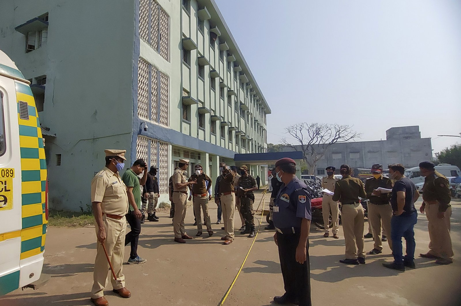 Police officers investigate the scene after a fire broke out at District General Hospital in Bhandara, about 70 kilometers (43 miles) from Nagpur, India, Jan. 9, 2021. (AP Photo)
