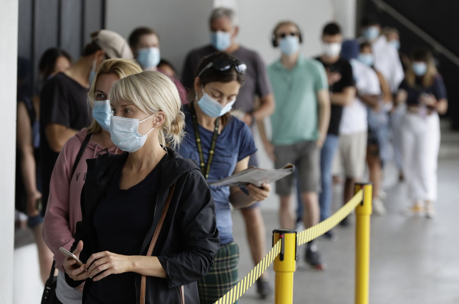 People wait in a line at a COVID-19 testing station on the northern beaches in Sydney, Australia, Dec. 21, 2020. (AP Photo)