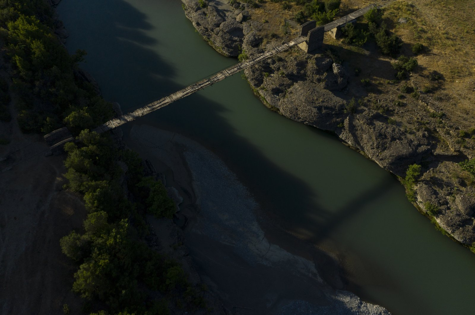 An old bridge spans the Vjosa River near the border with Greece, in Albania, June 30, 2019. (AP Photo)