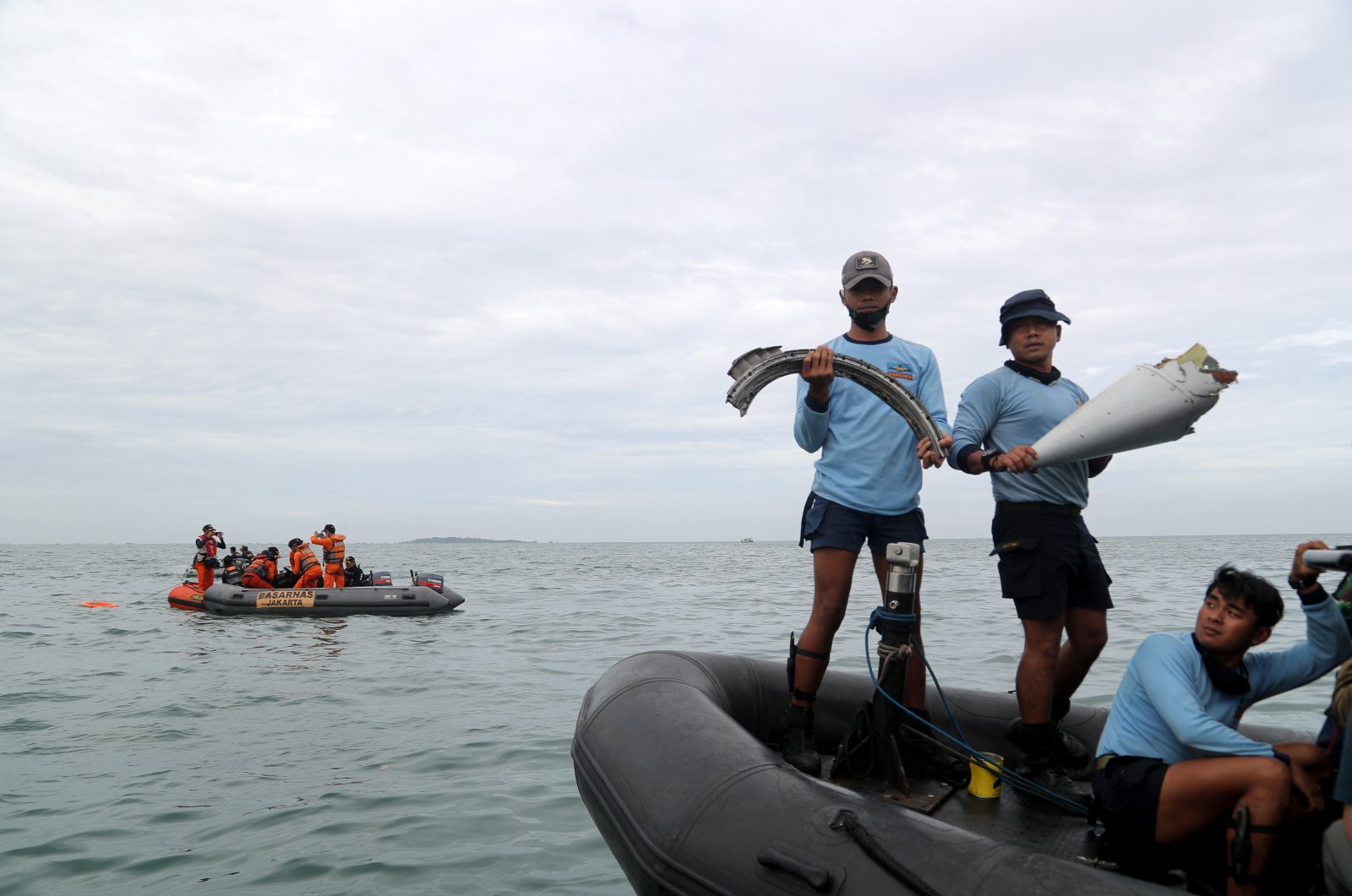 Indonesian Navy divers remove debris from the water during a search and rescue operation near the suspected crash site of Sriwijaya Air flight SJ182, near Tanjung Priok port in Jakarta, Indonesia, Jan. 10, 2021. (EPA Photo)
