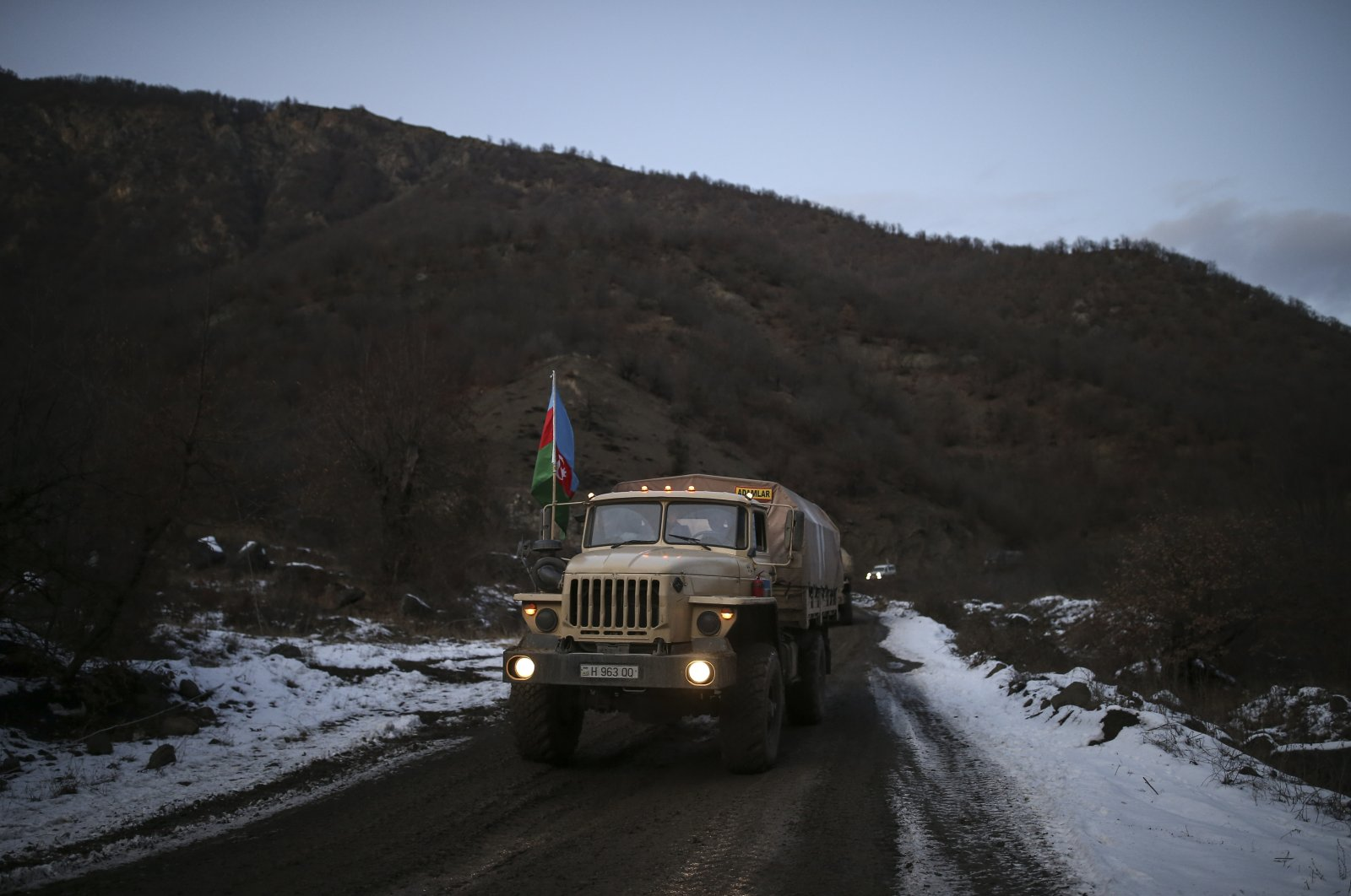 Azerbaijan's military trucks roll along a highway, near Kalbajar, Azerbaijan, Dec. 2, 2020. (AP Photo)