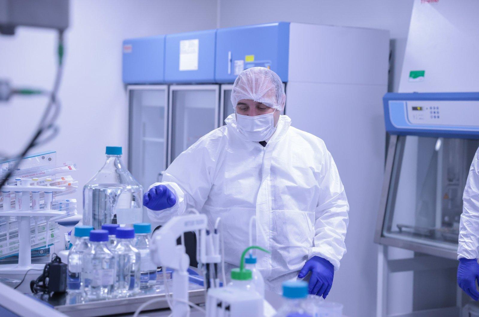 Industry and Technology Minister Mustafa Varank inspects laboratory equipment at Nobel Pharmaceutical's biotechnological medicine facilities in Istanbul, Turkey, Jan. 10, 2021. (IHA Photo)