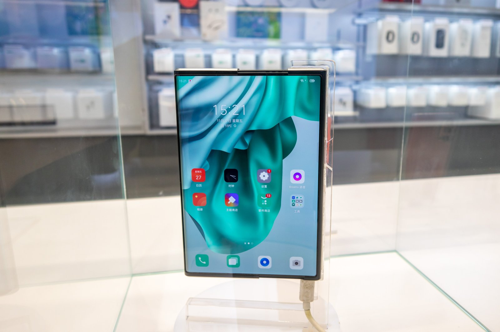 OPPO X 2021 scroll screen concept mobile phone is displayed at OPPO store on Nanjing East Road Pedestrian Street in Shanghai, China, Nov. 27, 2020. (Photo by Getty Images)
