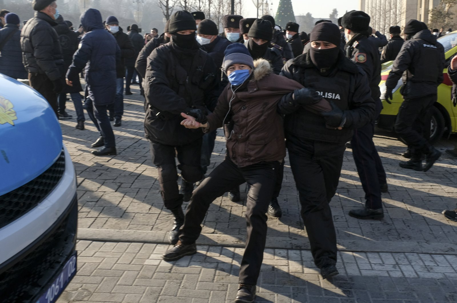 Kazakh police officers detain a protester during an opposition rally in Almaty, Kazakhstan, Sunday, Jan. 10, 2021 (AP Photo)