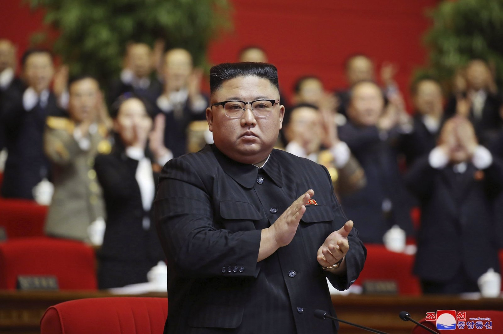 In this photo provided by the North Korean government, North Korean leader Kim Jong Un claps his hands at the ruling party congress in Pyongyang, North Korea, Jan. 10, 2021. (Korean Central News Agency via AP)