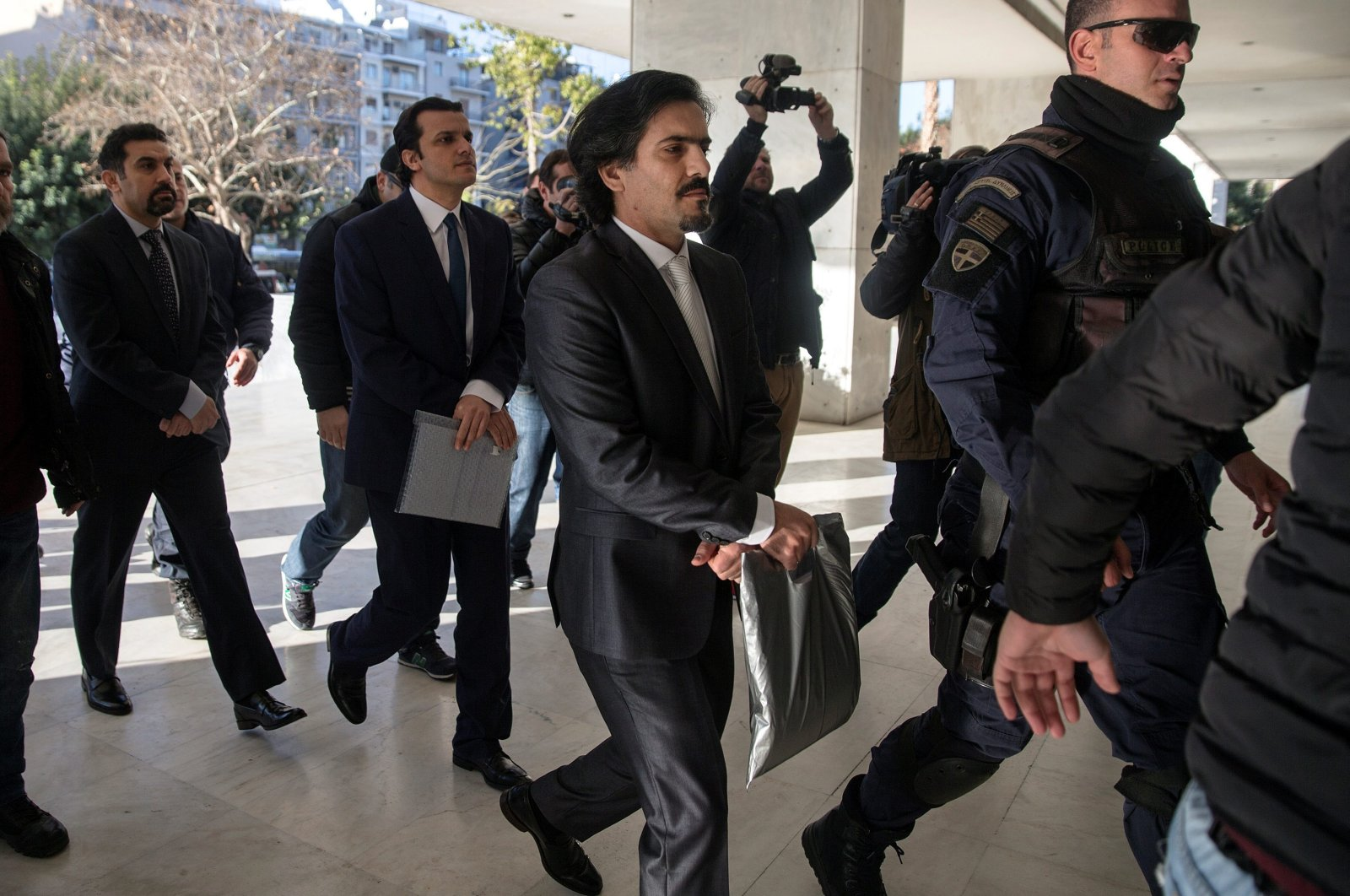 Three of the eight Turkish soldiers (C, 2nd L and L), who fled to Greece in a helicopter and requested political asylum after a failed military coup against the government, are escorted by police officers as they arrive at the Supreme Court in Athens, Greece, Jan. 13, 2017. (Reuters Photo)