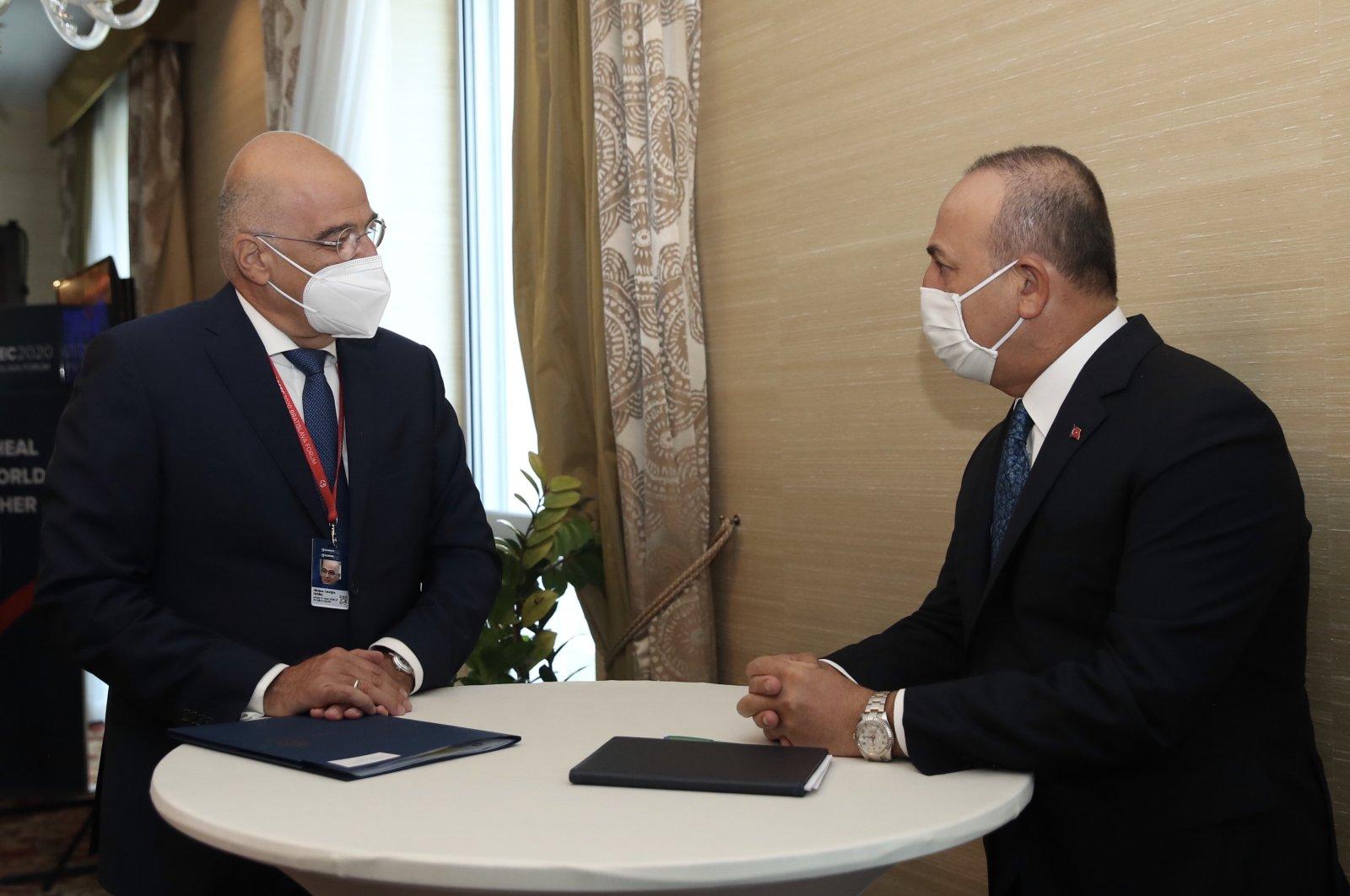 Greece's Foreign Minister Nikos Dendias (L) and Turkey's Foreign Minister Mevlüt Çavuşoğlu talk during a forum in Bratislava, Slovakia, Oct. 9, 2020. (AA Photo)