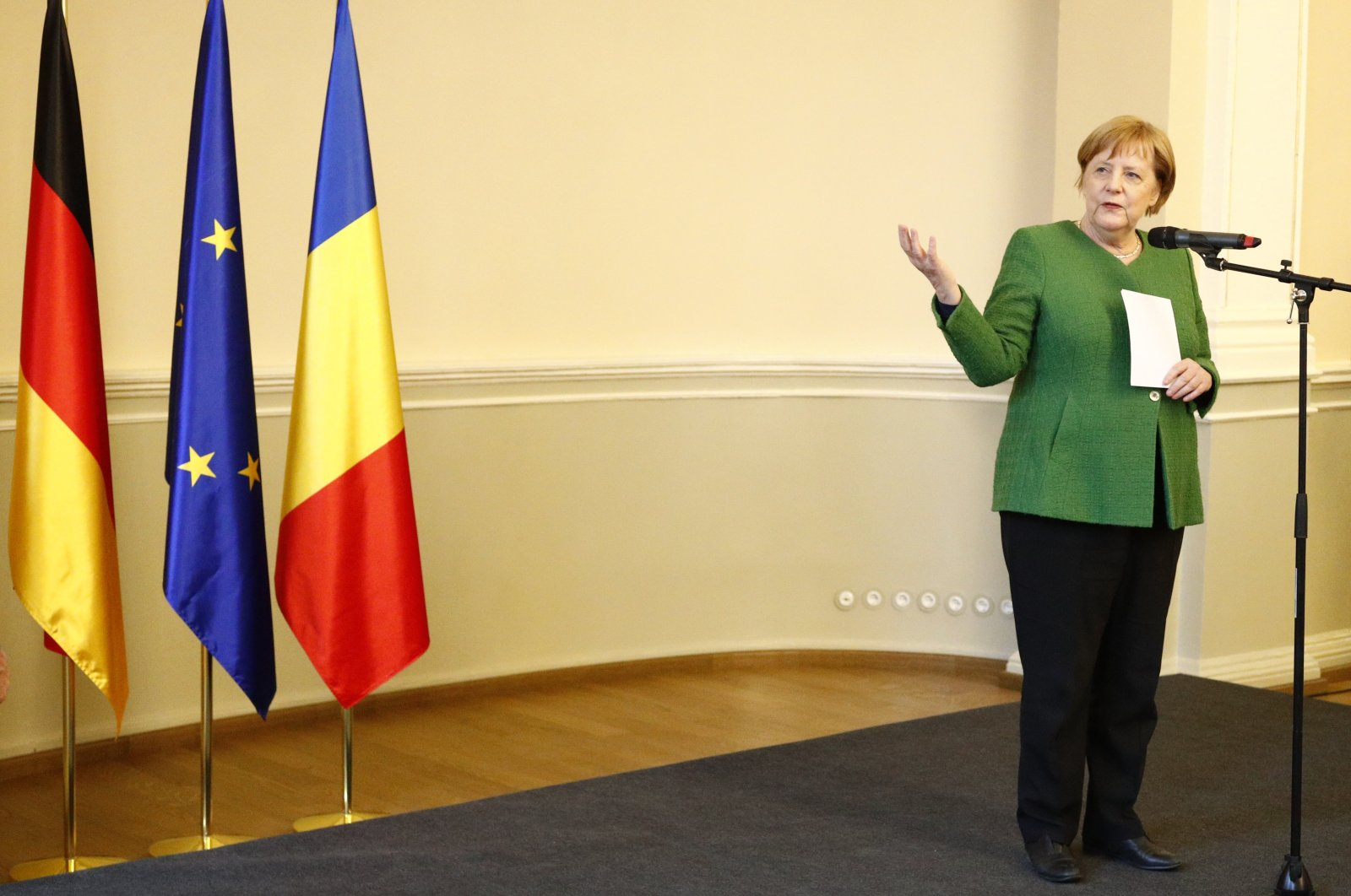 German Chancellor Angela Merkel delivers a speech during a meeting with members of Romania's German minority after an informal European Union summit, Sibiu, Romania, on May 9, 2019. (AP Photo)