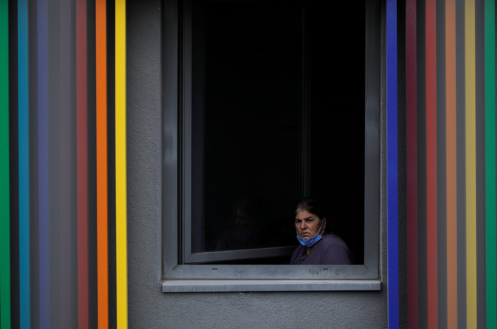 A woman looks out from a dormitory where she is placed under quarantine after returning from abroad, in Istanbul, Turkey, March 18, 2020. (REUTERS Photo)