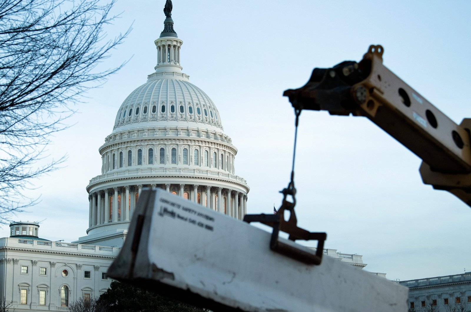 A crowd-control fence is reenforced with concrete barriers a day after pro-Donald Trump protesters broke into the U.S. Capitol, Washington, D.C., U.S., Jan. 7, 2021. (AFP Photo)
