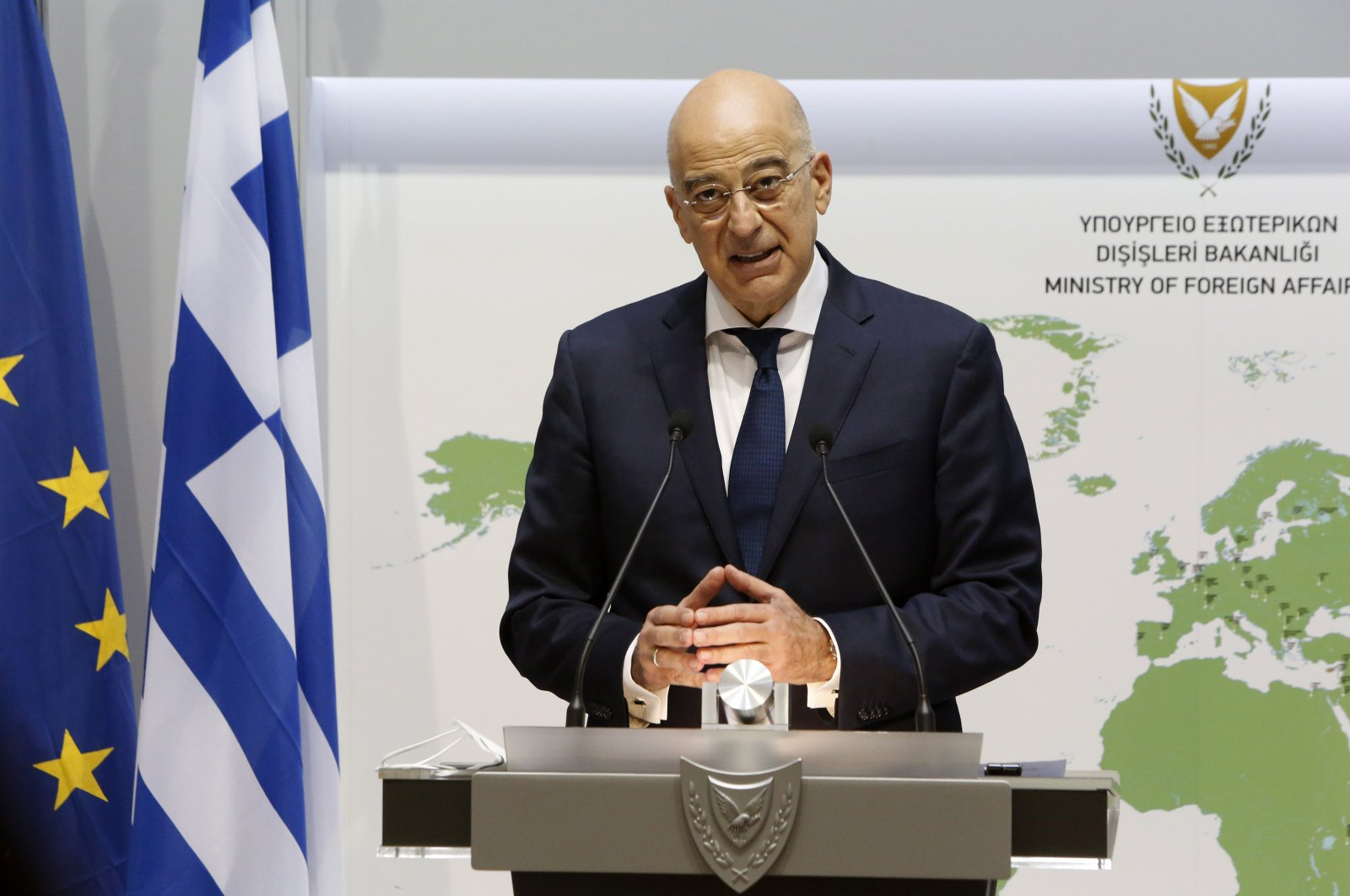 Greek Foreign Minister Nikos Dendias talks to the media during a news conference after a meeting with his Greek Cypriot counterpart Nicos Christodoulides at the foreign ministry house in the divided Cypriot capital Nicosia, Greek Cyprus, Dec. 4, 2020. (AP Photo)