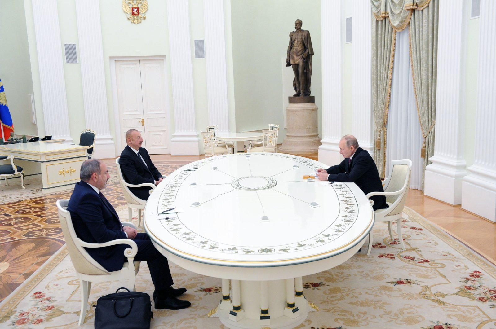 Russian President Vladimir Putin (R) holds a meeting with Armenian Prime Minister Nikol Pashinian (L) and Azerbaijani President Ilham Aliyev over the Nagorno-Karabakh region's future at the Kremlin in Moscow, Russia, Jan. 11, 2021. (AFP Photo)