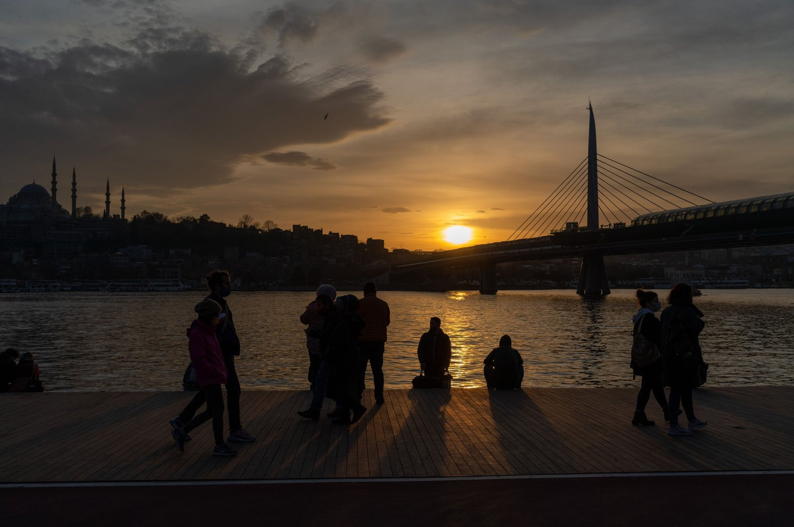 People enjoy the sunset view in Istanbul, Turkey, Jan. 8, 2021. (Getty Images)