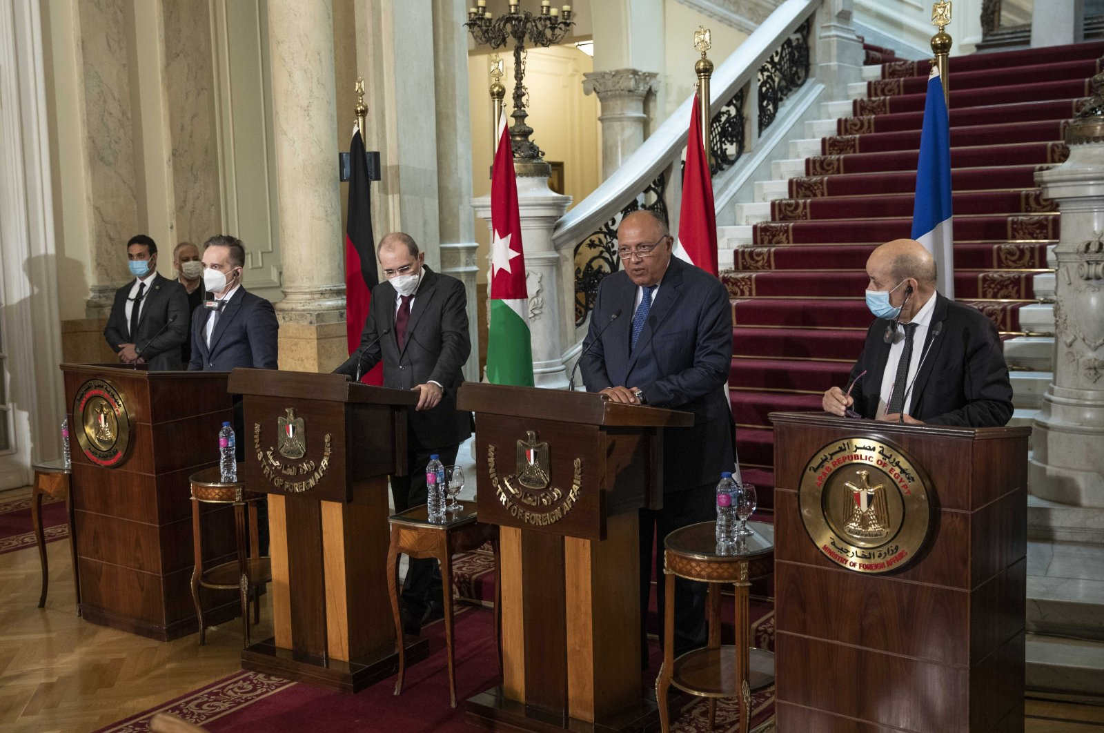 From left to right, German Foreign Minister Heiko Maas, Jordanian Foreign Minister Ayman Safadi, Egyptian Foreign Minister Sameh Shoukry and French Foreign Minister Jean-Yves Le Drian hold a news conference at Tahrir Palace, in Cairo, Egypt, Jan. 11, 2021. (AP Photo)