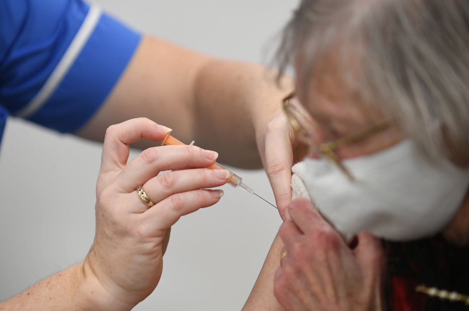 Heather Gallagher, 93, receives an injection of a COVID-19 vaccine at the National Health Service (NHS) vaccine center at Robertson House, Stevenage, England, Jan. 11, 2021. (Getty Images)