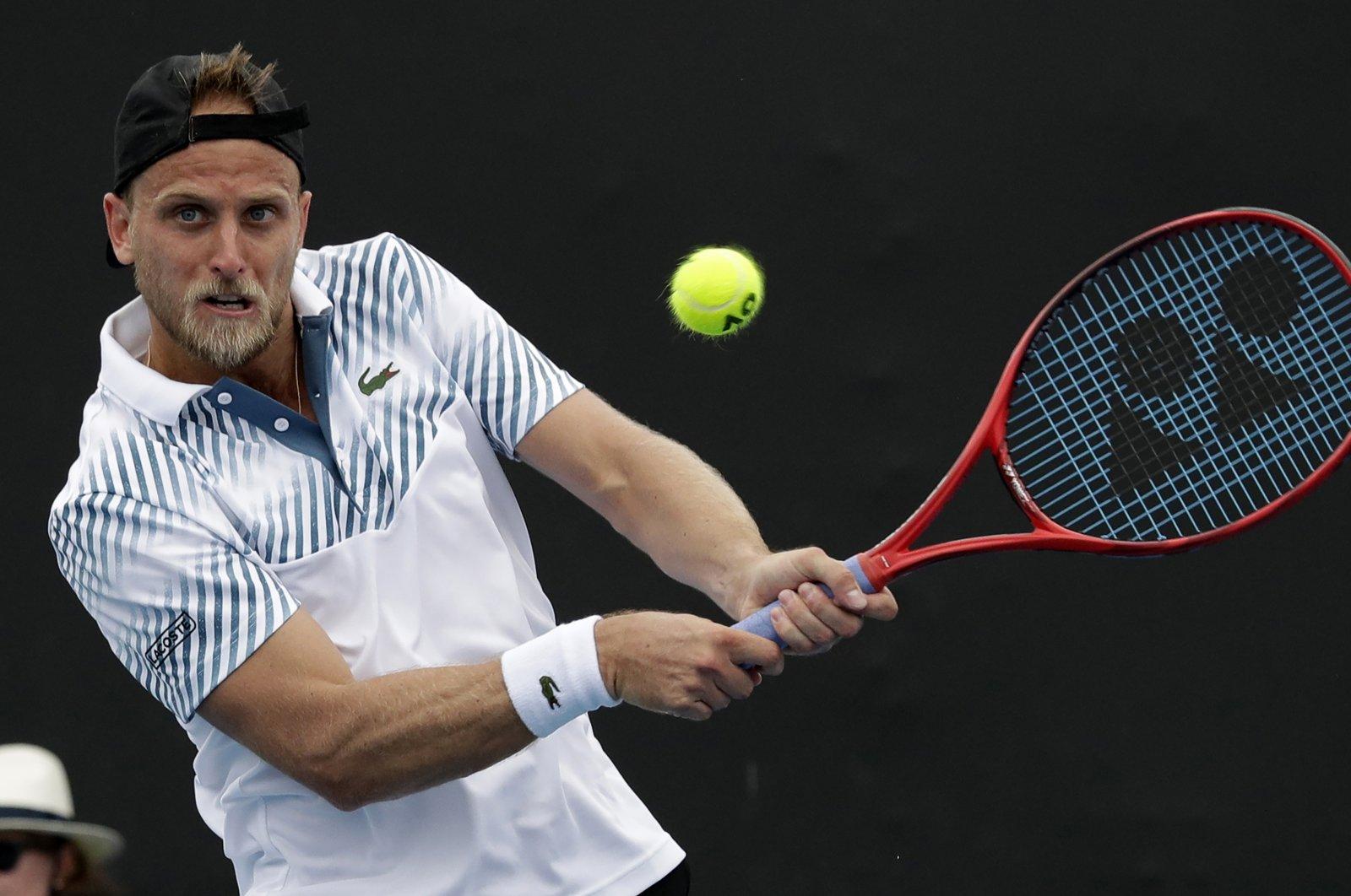 Denis Kudla plays a shot to Diego Schwartzman during an Australian Open tennis match, in Melbourne, Australia, Jan. 16, 2019. (AP Photo)