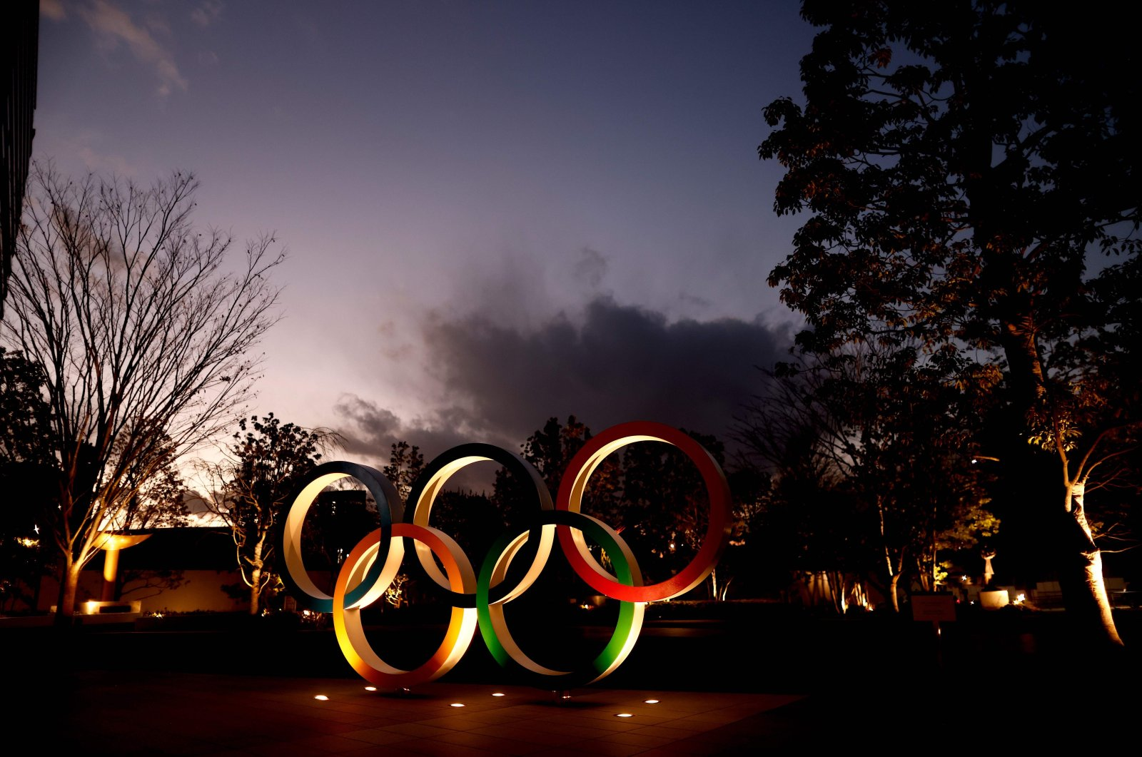 Olympic Rings are seen near the National Stadium, the main venue for the Tokyo 2020 Olympic and Paralympic Games, in Tokyo, Japan, Jan. 8, 2021. (AFP Photo)