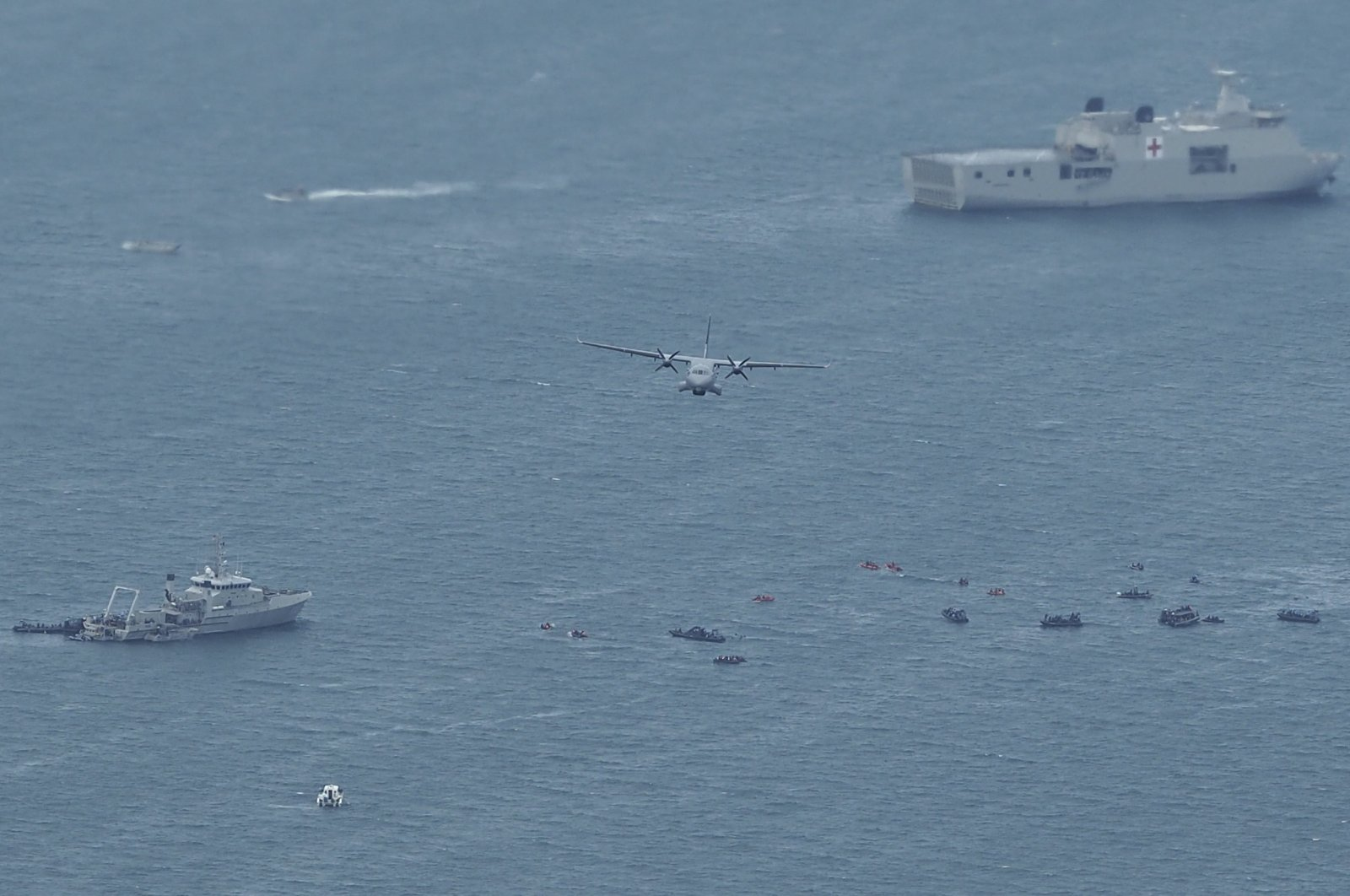 Indonesian Navy's aircraft flies by as the search for the wreckage of a crashed Sriwijaya Air passenger jet continues, in this aerial photo taken over the Java Sea, off Jakarta, Indonesia, Jan. 12, 2021. (AP Photo)
