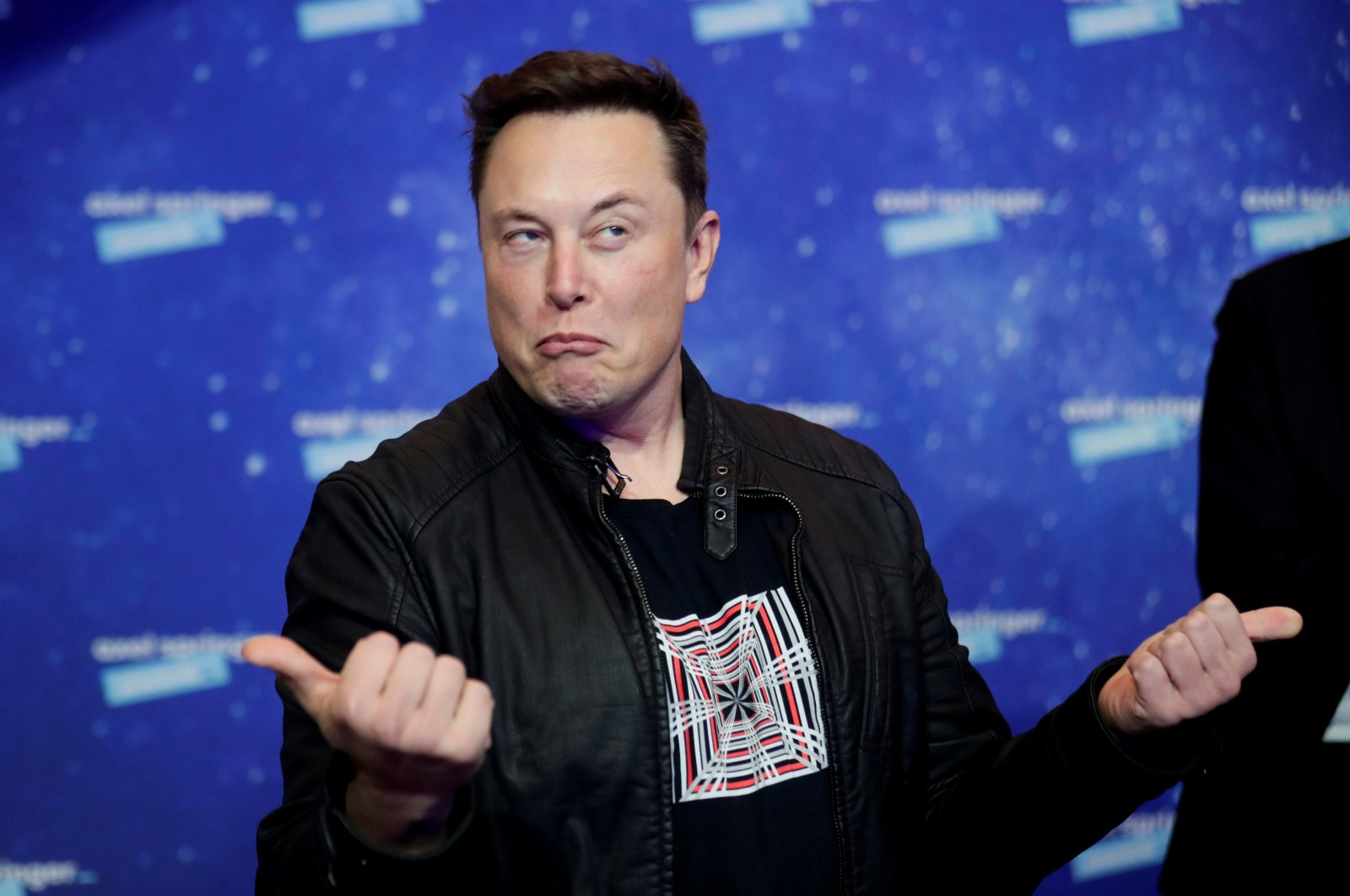 Tesla and SpaceX founder Elon Musk grimaces after arriving on the red carpet for the Axel Springer award, in Berlin, Germany, Dec. 1, 2020. (Reuters Photo)
