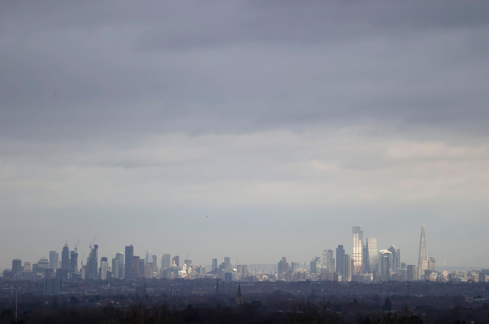 A picture taken from Epsom Downs Racecourse shows the skyline of London including the office buildings and skyscrapers of the City of London (R), in Epsom, southern England, on Jan. 11, 2021. (AFP Photo)