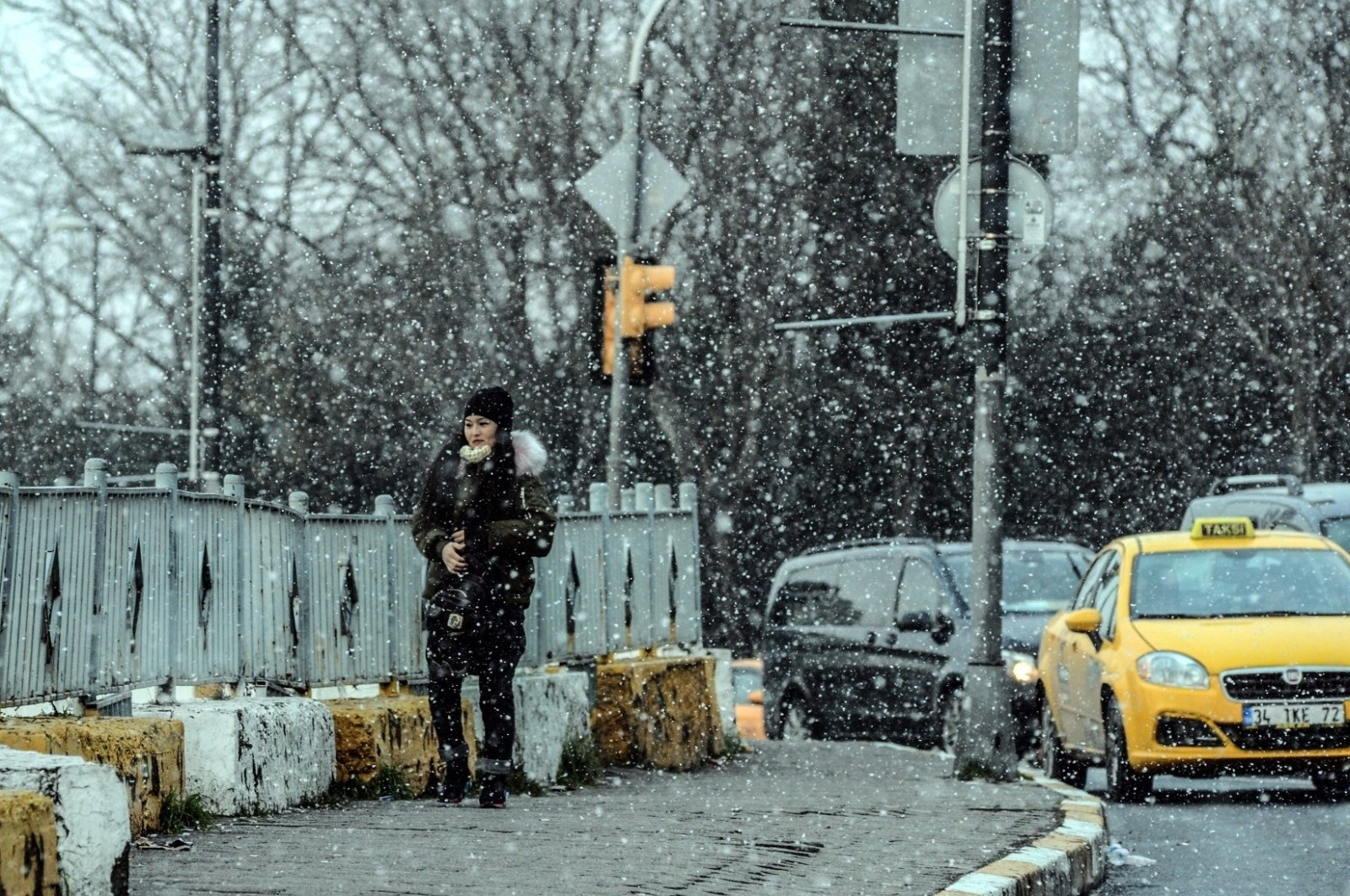 A woman walks on a street as snow falls in Istanbul, Turkey, Jan. 8, 2019. (AA Photo)